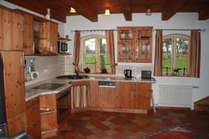 Die gemütliche Wohnküche lädt zum Kochen ein